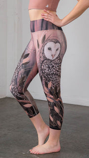 closeup left side view of model wearing owl themed capri leggings