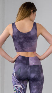 back view of model wearing watercolor inspired reversible tank top with purple on one side and mauve/pink on the other side