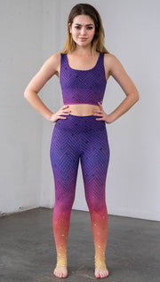 Front view of a model wearing purple/pink/yellow ombre mosaic tile print full length leggings