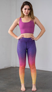 Full length front view of a model wearing purple/pink/yellow ombre mosaic tile print full length leggings