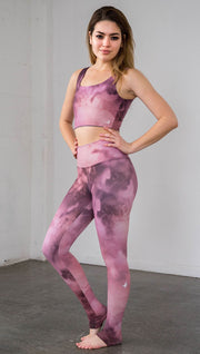 left side view of model wearing rose quartz stone design printed full length leggings