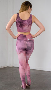 back view of model wearing rose quartz stone design printed full length leggings