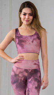 front view of model wearing watercolor inspired reversible tank top with purple on one side and mauve/pink on the other side