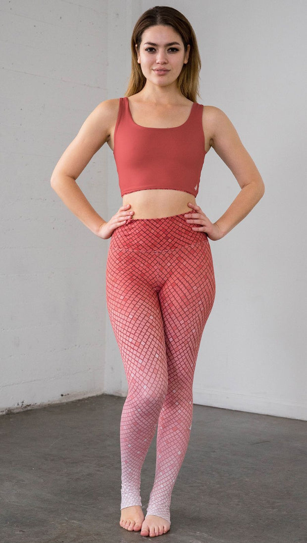 Full length front view of a model wearing coral ombre mosaic tile print leggings with a matching top