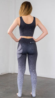 Back view of mosaic printed full length leggings with eagle artwork on left hip