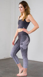 Left side view of mosaic printed capri leggings with eagle artwork on left hip