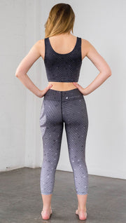 Back view of mosaic printed capri leggings with eagle artwork on left hip