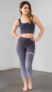 Front view of mosaic printed capri leggings with eagle artwork on left hip