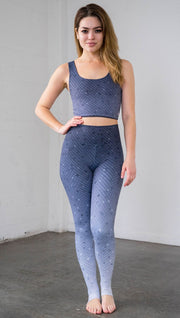 Full length front view of a model wearing muted blue mosaic tile print ombre leggings