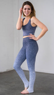 Full length front left view of a model wearing muted blue mosaic tile print ombre leggings