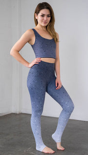 Full length front right view of a model wearing muted blue mosaic tile print ombre leggings