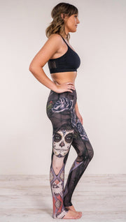 Right side view of model wearing sugar skull themed printed full length leggings