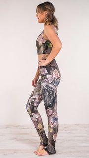 Side view of model wearing unicorn and rose printed full length leggings