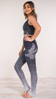 Left side view of mosaic printed full length leggings with eagle artwork on left hip