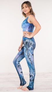 Left side view of model wearing jellyfish themed printed full length leggings