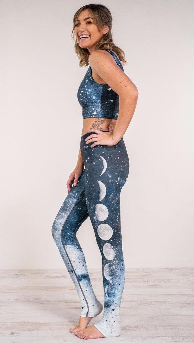 Left side view of model wearing moon cycle themed full length leggings