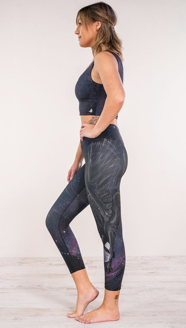 Side view of model wearing fantasy flying pegasus themed printed leggings