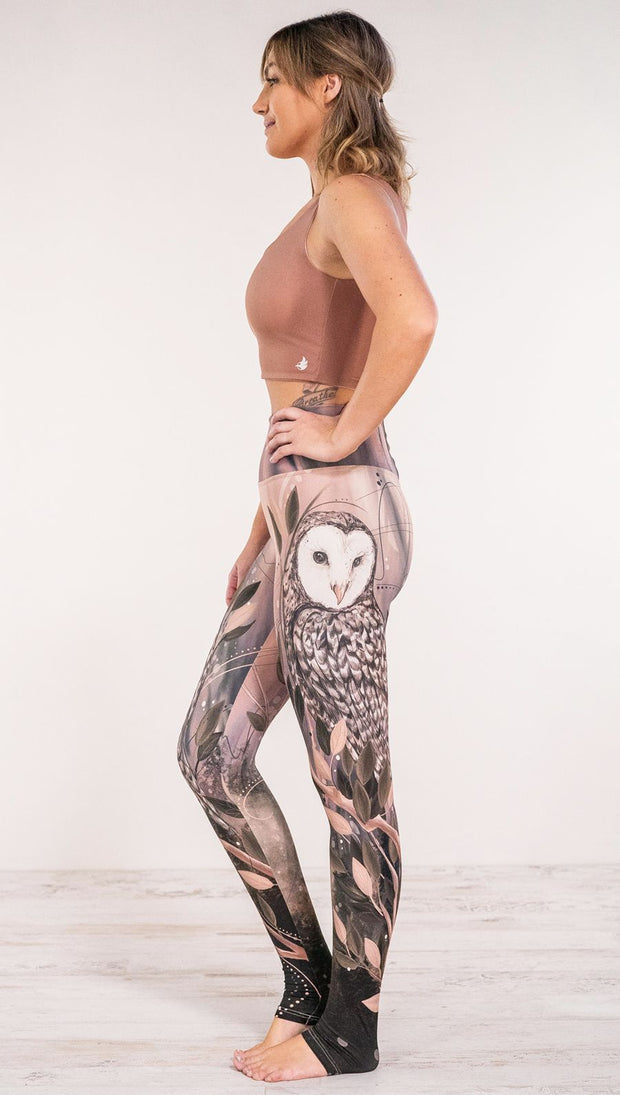 Side view of model wearing owl themed full length leggings