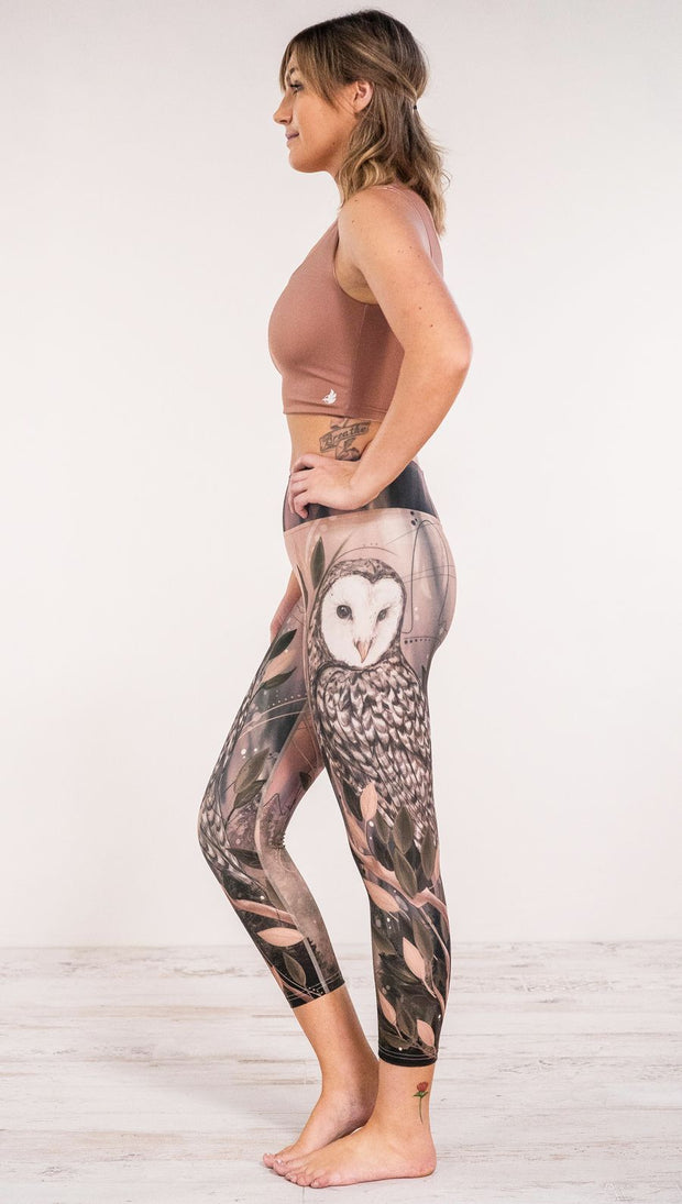 Side view of model wearing owl themed leggings