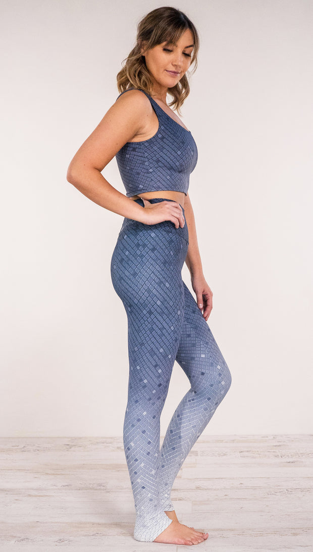 Right side view of a model wearing muted blue mosaic tile print ombre leggings