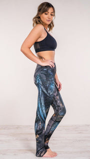 Right side view of model wearing gothic themed printed full length leggings