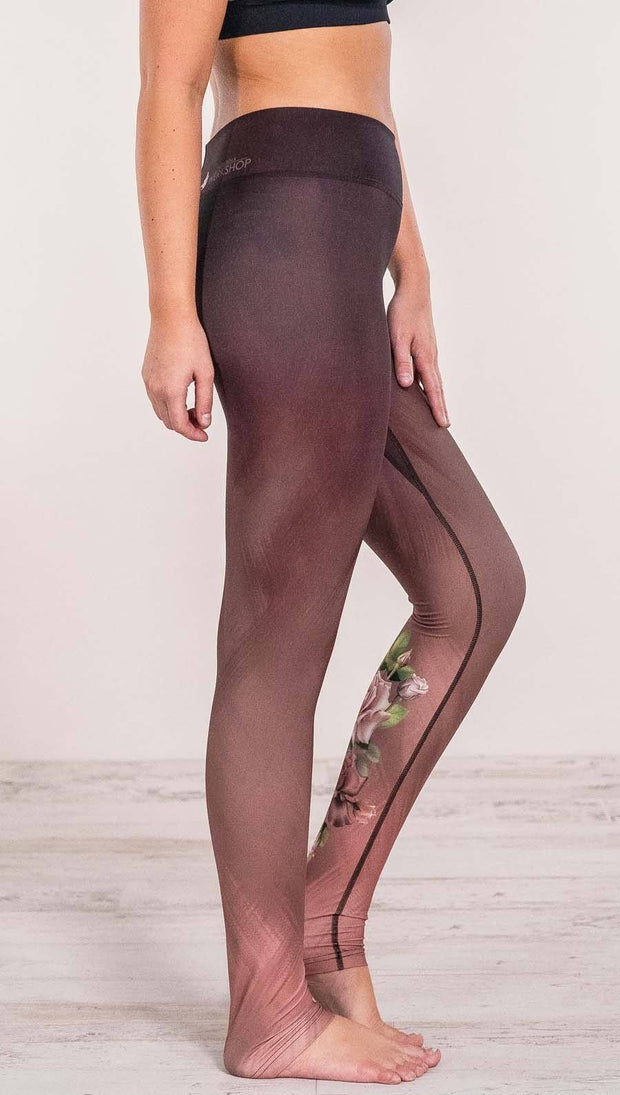 Close up right side view of model wearing tattoo rose design printed full length leggings