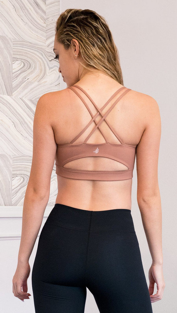 back view of model wearing brown cinnamon colored sports bra