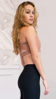 right side view of model wearing brown cinnamon colored sports bra