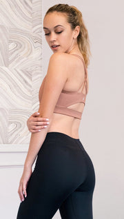 left side view of model wearing brown cinnamon colored sports bra
