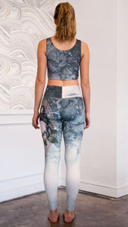 back view of model wearing full length Finnish Lapphund artwork themed leggings