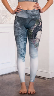 closeup front view of model wearing full length Finnish Lapphund artwork themed leggings