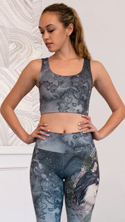 front view of model wearing watercolor artwork themed reversible sports top
