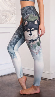 closeup left side view of model wearing full length Finnish Lapphund artwork themed leggings