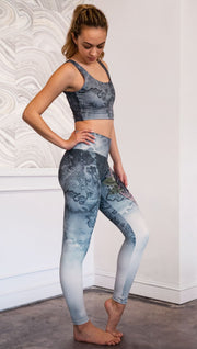 right side view of model wearing full length Finnish Lapphund artwork themed leggings