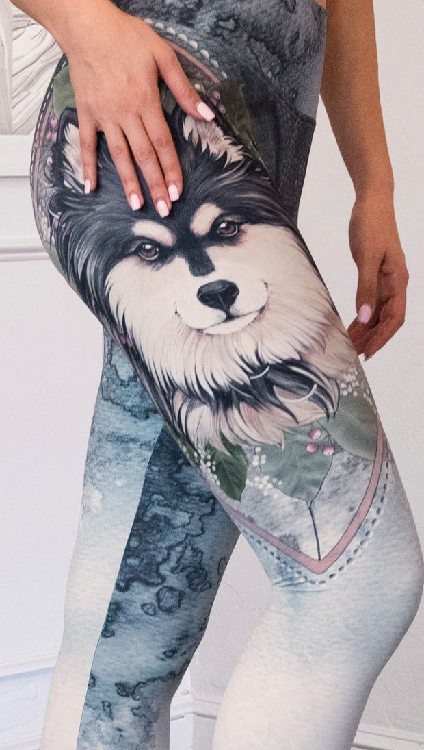 closeup right side view of model wearing full length Finnish Lapphund artwork themed leggings