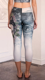 closeup back view of model wearing capri Finnish Lapphund artwork themed leggings