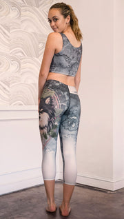 back view of model wearing capri Finnish Lapphund artwork themed leggings