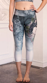 closeup front view of model wearing capri Finnish Lapphund artwork themed leggings