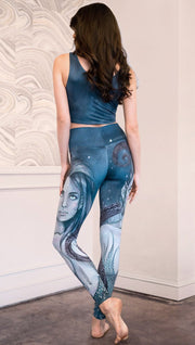 back view of model wearing full length leggings with mermaid and tentacles printed design