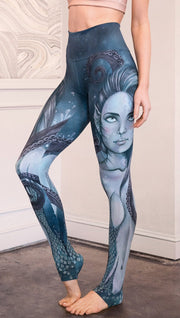 closeup left side view of model wearing full length leggings with mermaid and tentacles printed design