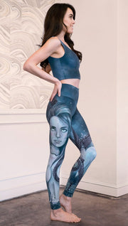 right side view of model wearing full length leggings with mermaid and tentacles printed design