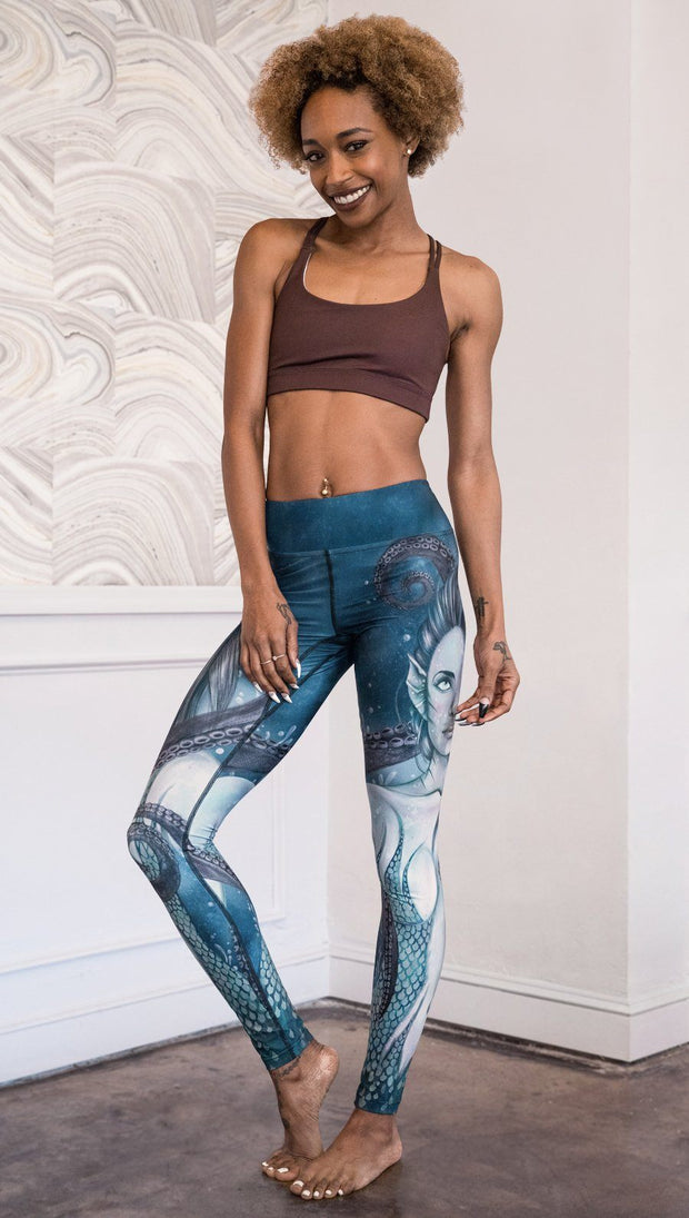 front view of model wearing full length leggings with mermaid and tentacles printed design