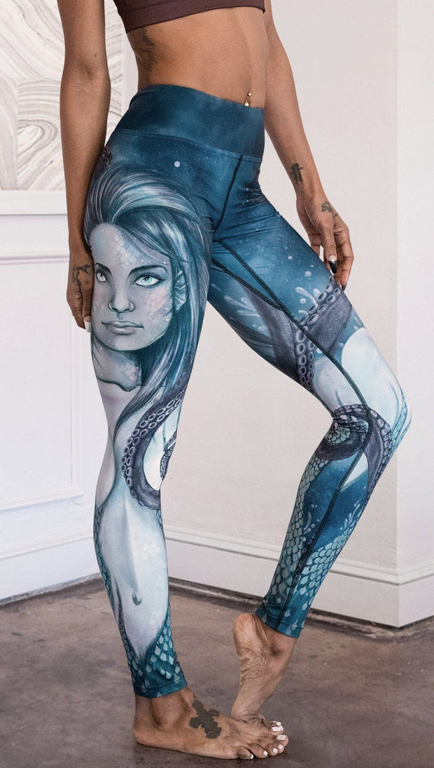 closeup right side view of model wearing full length leggings with mermaid and tentacles printed design