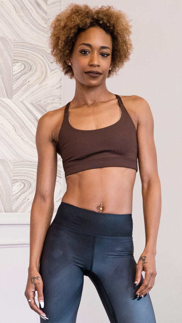front view of model wearing nude / mocha tone sports bra