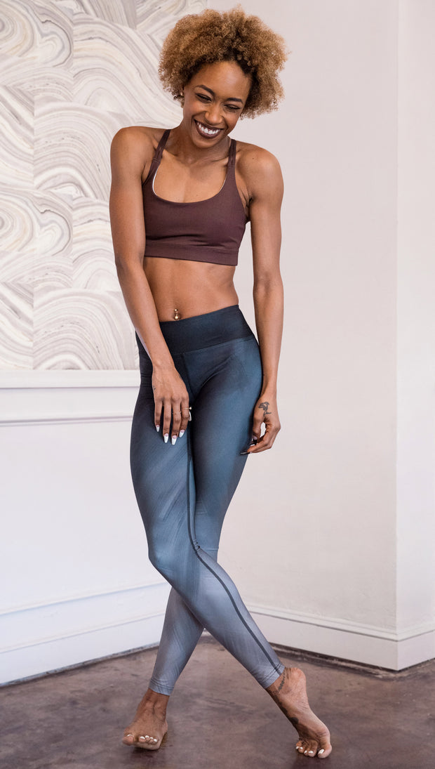 front view of model wearing rose themed full length leggings