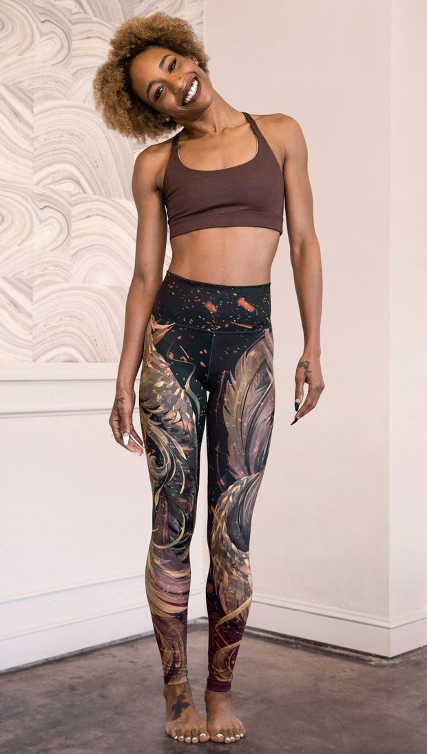 front view of model wearing phoenix themed full length leggings