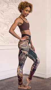 right side view of model wearing phoenix themed full length leggings