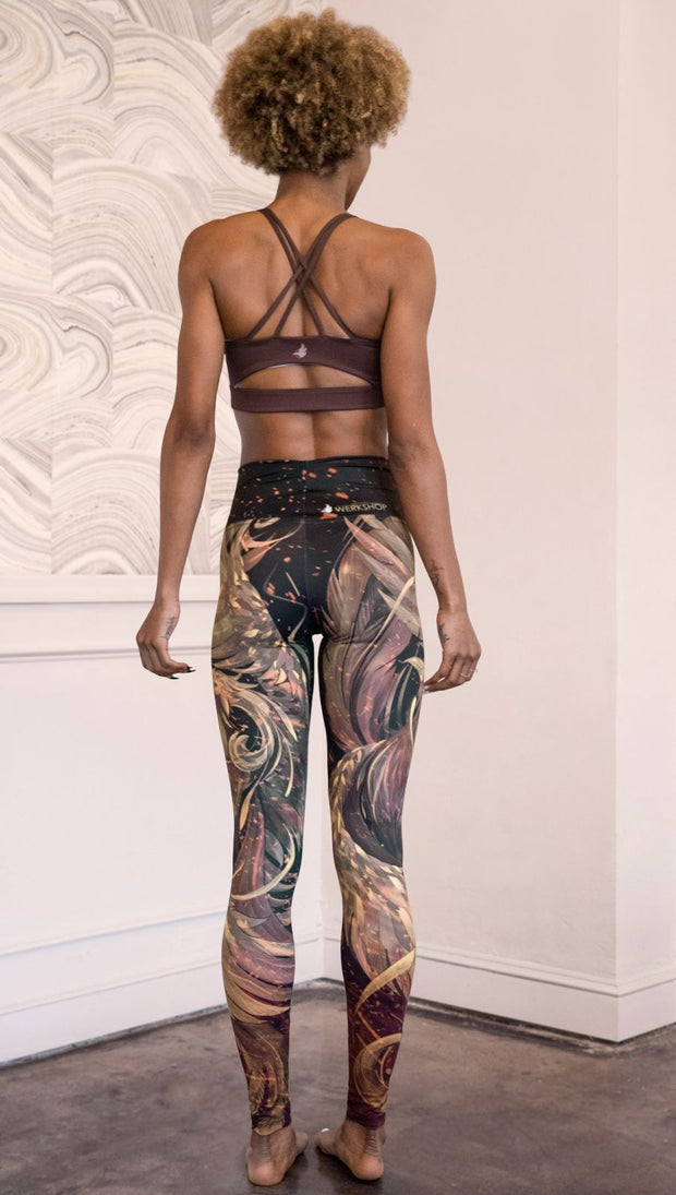 back view of model wearing phoenix themed full length leggings