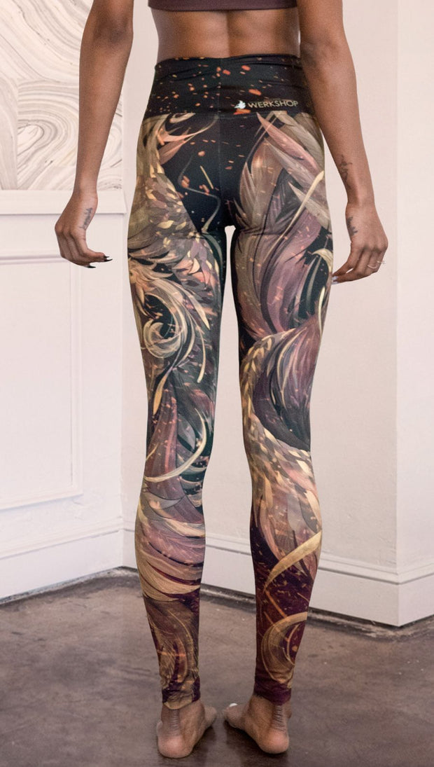 closeup back view of model wearing phoenix themed full length leggings