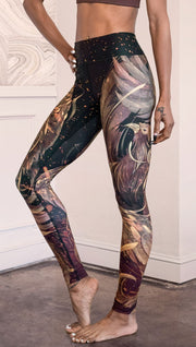 closeup left side view of model wearing phoenix themed full length leggings